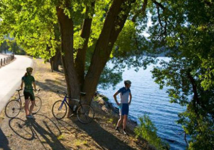 If you're searching for the perfect way to see North Idaho, grab your helmet. The best tour guide is right outside the doors of The Coeur d'Alene Resort — The North Idaho Centennial Trail.