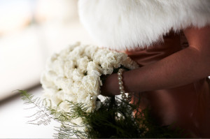 Resort Wedding Photo - Bride With Pearl Bracelet and Furry Coat